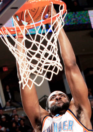 photo - The Thunder&amp;#8217;s James Harden slams in two points against Philadelphia during action Wednesday night.  Photo By John Clanton, The Oklahoman