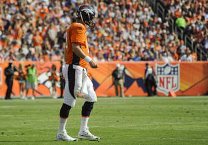 Photo -   Denver Broncos quarterback Peyton Manning (18) walks off the field in the second quarter of an NFL football game against the Houston Texans, Sunday, Sept. 23, 2012, in Denver. (AP Photo/Jack Dempsey)