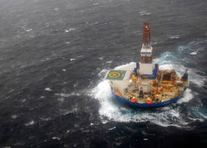 photo - In this photo provided by the U.S. Coast Guard, the mobile drilling unit Kulluk is towed by the tugs Aiviq and Nanuq in 29 mph winds and 20-foot seas 116 miles southwest of Kodiak City, Alaska, Sunday, Dec. 30, 2012. The crews remain stationed with the drill rig Kulluk Sunday 20 miles from Alaska's Kodiak Island as they wait in rough seas for another tug boat to arrive. The Coast Guard says the goal is to tow the Kulluk to a safe harbor and determine the next step. (AP Photo/U.S Coast Guard, Chris Usher)