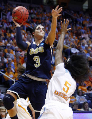 Photo - Oral Roberts forward Taylor Cooper (3) shoots over Tennessee guard Ariel Massengale (5) in the first half of a first-round game in the women's NCAA college basketball tournament on Saturday, March 23, 2013, in Knoxville, Tenn. (AP Photo/Wade Payne)