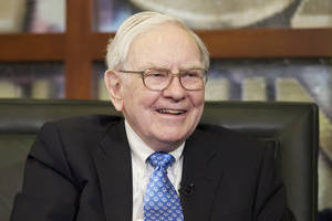 Photo - FILE - In this Monday, May 6, 2013, file photo, Warren Buffett smiles during an interview with Liz Claman of the Fox Business Network in Omaha, Neb. The Berkshire Hathaway company reports quarterly earnings on Friday, Nov. 1, 2013. (AP Photo/Nati Harnik, File)