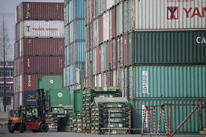 Photo -  A forklift arranges the shipping containers near a port in Shanghai. AP Photo  <strong>Eugene Hoshiko -  AP </strong>