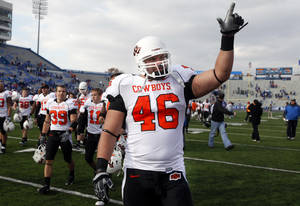 Photo - Oklahoma State's Shane Jarka (46) celebrates the Cowboys'  win over Kansas, Saturday, Nov. 20, 2010 at Memorial Stadium in Lawrence, Kan. Photo by Sarah Phipps, The Oklahoman