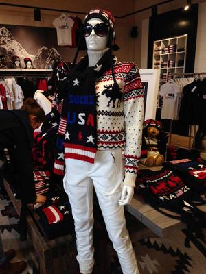 Photo - A mannequin wears a wool sweater, scarf and hat by American designer Ralph Lauren in the pop-up shop at USA House in Olympic Park in Sochi, Russia, on Wednesday, Feb. 19, 2014. The shop sells some of the same clothing worn by American athletes in the Olympic opening ceremony, along with USA Hockey gear. (AP Photo/Beth Harris)