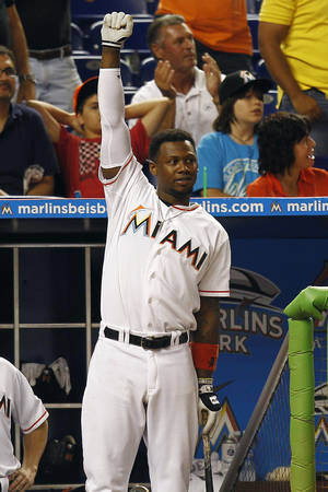 Photo -   Miami Marlins' Hanley Ramirez cheers as he watches Logan Morrison hit a home run during the seventh inning of a baseball game against the St. Louis Cardinals in Miami, Wednesday, June 27, 2012. The Marlins won 5-3. (AP Photo/J Pat Carter)