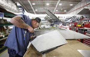 Photo - AAR sheet metal mechanic Randy Smith works on an exhaust flap.  PHOTO BY STEVE GOOCH, THE OKLAHOMAN