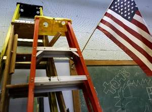 photo - Ladders are stacked near the chalkboard in a classroom at Classen School of Advanced Studies in Oklahoma City on Monday, Feb. 22, 2010. Photo by John Clanton