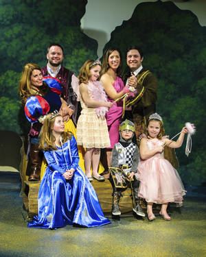 Photo - Preparing for the Fairy Tale Ball are, from left, Kristen and Matt Brown and Katherine and Cooper Johnson and their children, Bella Brown, Hannah Kate Johnson, Mica Brown and Hailey Jane Johnson.  PHOTO PROVIDED BY OKLAHOMA CHILDREN'S THEATRE