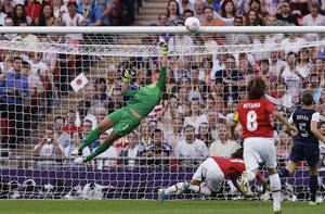 Photo -   United States goalkeeper Hope Solo (1) makes a save against Japan during the women's soccer gold medal match at the 2012 Summer Olympics, Thursday, Aug. 9, 2012, in London. (AP Photo/Ben Curtis)