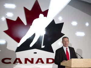 Photo - Kevin Dineen speaks during a news conference where he was introduced as the new head coach of Canada's national women's hockey team, Tuesday, Dec. 17, 2013 in Calgary, Alberta. (AP Photo/The Canadian Press, Larry MacDougal)