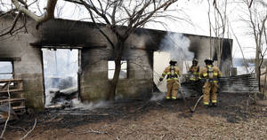 Photo - Norman firefighters work to extinguish a blaze in a barn Thursday on 36th Avenue SE near Post Oak Road. PHOTO BY STEVE SISNEY, THE OKLAHOMAN <strong>STEVE SISNEY</strong>