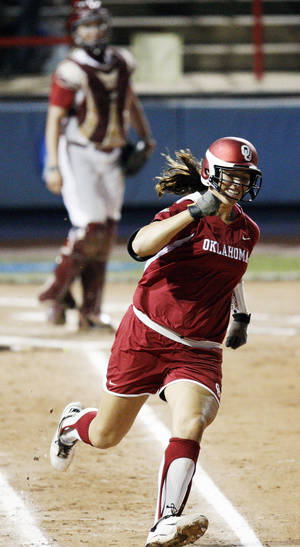 Photo - Oklahoma's Keilani Ricketts (10) runs the bases after hitting a home run in the 2nd inning during Game 3 of the Women's College World Series softball championship between OU and Alabama at ASA Hall of Fame Stadium in Oklahoma City, Wednesday, June 6, 2012.  Photo by Nate Billings, The Oklahoman