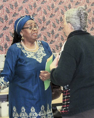 photo - Marcia Muhammad, left, talks to Oklahoma City School Board Chairwoman Angela Monson after a hearing Tuesday morning at the Oklahoma County Election Board. Monson challenged Muhammad's eligibility to run for the at-large position of board chairman, and the election board ruled Muhammad's name could not appear on the ballot because of her criminal record.  PHOTO BY  CARRIE COPPERNOLL, THE OKLAHOMAN