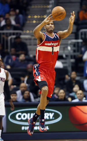 Photo - Washington Wizards forward Trevor Ariza (1) hits a 3-point basket from beyond half-court as the buzzer sounded to end the third quarter of an NBA basketball game against the Atlanta Hawks Wednesday, Feb. 19, 2014, in Atlanta. Washington won 114-97. (AP Photo/John Bazemore)