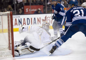 photo - Toronto Maple Leafs left winger James van Riemsdyk (21) scores on Buffalo Sabres goaltender Ryan Miller during the second period of their NHL hockey game, Thursday, Feb. 21, 2013, in Toronto. (AP Photo/The Canadian Press, Frank Gunn)