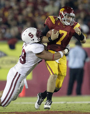 Photo -   FILE - In this Oct. 29, 2012, file photo, Stanford defensive end Ben Gardner, left, sacks Southern California quarterback Matt Barkley during the second half of an NCAA college football game in Los Angeles The secondary has become a weak spot for Stanford. And with Andrew Luck no longer around to match Barkley, the No. 21 Cardinal must find a way to slow No. 2 Southern California's passing game Saturday night in a rematch of last season's triple-overtime thriller. (AP Photo/Jae C. Hong, File)