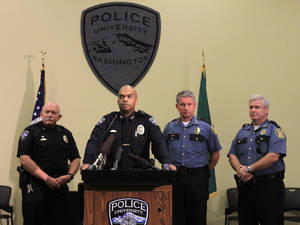 Photo - UW Police Chief John Vinson, at podium, discusses the stop of a truck containing molotov-cocktail like incendiary devices and the on-going investigation and stolen guns, Thursday, July 4, 2013. Left is UW Deputy Police Chief Randy West, then Vinson, SPD Chief Jim Pugel and then Assistant Chief Paul McDonagh (AP Photo/The Seattle Times, Alan Berner) OUTS: SEATTLE OUT, USA TODAY OUT, MAGAZINES OUT, TELEVISION OUT, SALES OUT. MANDATORY CREDIT TO: ALAN BERNER/THE SEATTLE TIMES