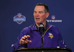 Photo - Minnesota Vikings head coach Mike Zimmer answers a question during a news conference at the NFL football scouting combine in Indianapolis, Friday, Feb. 21, 2014. (AP Photo/Michael Conroy)