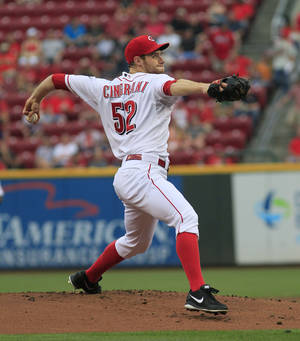 Photo - Cincinnati Reds' Tony Cingrani pitches against the Arizona Diamondbacks in the first inning of a baseball game in Cincinnati on Tuesday Aug. 20, 2013. (AP Photo/Tom Uhlman)