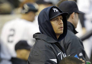 Photo -   New York Yankees' Alex Rodriguez watches from the dugout during the fourth inning of Game 5 of the American League division baseball series against the Baltimore Orioles, Friday, Oct. 12, 2012, in New York. (AP Photo/Kathy Willens)