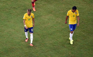 Photo - Brazil's Neymar, left, and Paulinho leave the pitch after the group A World Cup soccer match between Brazil and Mexico at the Arena Castelao in Fortaleza, Brazil, Tuesday, June 17, 2014.  (AP Photo/Francois Xavier Marit, pool)