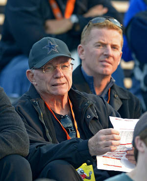 Photo - Dallas Cowboys owner Jerry Jones looks over the action with Cowboys coach Jason Garrett, right, during Senior Bowl North Squad practice at Ladd-Peebles Stadium, Monday, Jan. 20, 2014 in Mobile, Ala.  (AP Photo/G.M. Andrews)