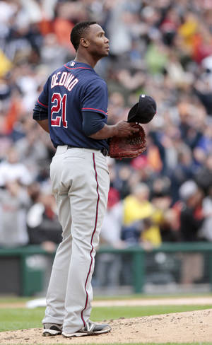 Photo -   Minnesota Twins pitcher Samuel Deduno looks to the outfield after giving up a three-run home run to Detroit Tigers' Delmon Young in the third inning of a baseball game Saturday, Sept. 22, 2012, in Detroit. (AP Photo/Duane Burleson)