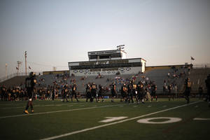 Photo - Midwest City practices before a high school football game between Midwest City and Norman North in Midwest City, Friday, Sept. 21, 2012.  Photo by Garett Fisbeck, The Oklahoman