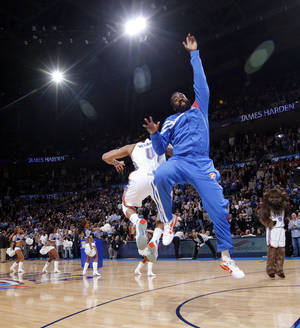 Photo - Oklahoma City's James Harden (13) and Russell Westbrook (0) leap during player introductions before the NBA basketball game between the Oklahoma City Thunder and Portland Trail Blazers at Chesapeake Energy Arena in Oklahoma City, Tuesday, Jan. 3, 2012. Portland won, 103-93. Photo by Nate Billings, The Oklahoman