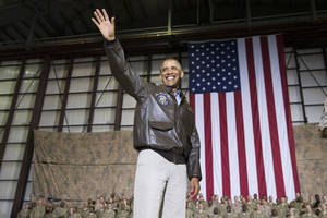 Photo - President Barack Obama waves as he arrives for a troop rally after arriving at Bagram Air Field for an unannounced visit, on Sunday, May 25, 2014, north of Kabul, Afghanistan. (AP Photo/ Evan Vucci)