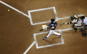 Photo - Milwaukee Brewers' Jonathan Lucroy hits a two-run scoring double during the third inning of a baseball game against the Pittsburgh Pirates, Tuesday, May 13, 2014, in Milwaukee. (AP Photo/Morry Gash)