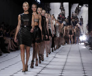 Photo -   Models, led by Carolyn Murphy, walk in the finale of the Jason Wu Spring 2013 collection during Fashion Week in New York, Friday, Sept. 7, 2012. (AP Photo/Richard Drew)