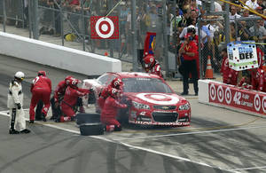 Photo - Crew members work to repair Kyle Larson's car during the NASCAR Daytona 500 Sprint Cup series auto race at Daytona International Speedway, Sunday, Feb. 23, 2014, in Daytona Beach, Fla.. (AP Photo/David Graham)