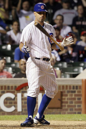 Photo -   Chicago Cubs' Reed Johnson tosses his bat after being called out on strikes during the ninth inning of an interleague baseball game against the Boston Red Sox in Chicago, Sunday, June 17, 2012. The Red Sox won 7-4. (AP Photo/Nam Y. Huh)