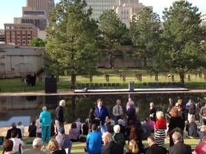 Photo - People gather for the 17th Anniversary Remembrance Ceremony Thursday morning in Oklahoma City. Photo by James Beckel