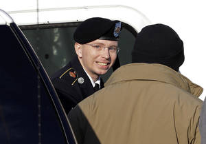 photo - FILE - In this Nov. 28, 2012 file photo, Army Pfc. Bradley Manning, center, steps out of a security vehicle as he is escorted into a courthouse in Fort Meade, Md., for a pretrial hearing.  A military judge hears closing arguments on Tuesday, Dec. 12, 2012, on whether a private charged with sending classified material to WikiLeaks suffered illegal pretrial punishment during nine months in a Marine Corps brig. Army Pfc. Bradley Mannings lawyers claim his treatment was so egregious that all charges should be dismissed. (AP Photo/Patrick Semansky, HO)