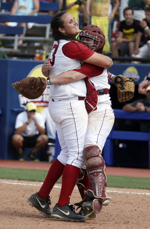 Photo - Alabama's Jackie Traina (33) and Molly Fichtner celebrate their win of the Women's College World Series softball tournament  game between Oregon and Alabama at ASA Hall of Fame Stadium in Oklahoma City, Sunday, June 1, 2014. Photo by Sarah Phipps, The Oklahoman