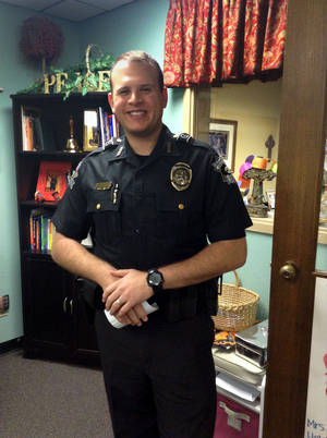 Photo - Ryan Locklear is nearing the end of his first month as school resource officer at St. Elizabeth Ann Seton in Edmond.   <strong></strong>