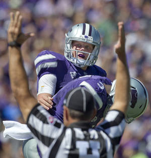 Photo -   Kansas State quarterback Collin Klein (7) celebrates his touchdown with wide receiver Chris Harper (3) during the second half of an NCAA football game against Miami in Manhattan, Kan., Saturday, Sept. 8, 2012. (AP Photo/Orlin Wagner)