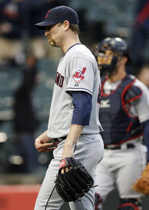 Photo - Cleveland Indians closer John Axford reacts as he leaves the field after Chicago White Sox's Alexei Ramirez hit the game-winning two-run home run during the ninth inning of a baseball game in Chicago on Sunday, April 13, 2014. The White Sox won 4-3. (AP Photo/Nam Y. Huh)