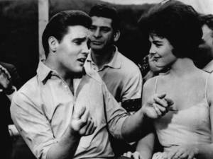 "Photo - FILE -   Elvis Presley, left, appears in a scene from the movie, ""Kid Galahad,"" in this undated file photo. A parent in a Salt Lake City suburb, who was upset about Elvis Presley songs in a high-school drama, prompted educators to cancel the production, deeming it too sexually suggestive. Presley's song lyrics and a scene suggesting cross-dressing were deemed offensive by West Jordan, Utah, school administrators. (AP Photo, file)"