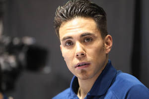 Photo - Apolo Anton Ohno is shown working from the broadcast booth before the women's 1,500 meters during the U.S. Olympic short track trials, Friday, Jan. 3, 2014, in Kearns, Utah. (AP Photo/Rick Bowmer)