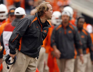Photo - OSU offensive coordinator Dana Holgorsen argues a call during the Cowboys' game against Nebraska earlier this season. PHOTO BY SARAH PHIPPS, THE OKLAHOMAN
