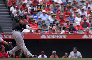 Photo - Pittsburgh Pirates' Pedro Alvarez hits a solo home run during the first inning of their baseball game against the Los Angeles Angels, Sunday, June 23, 2013, in Anaheim, Calif.  (AP Photo/Mark J. Terrill)