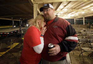Photo - Brad Pustejovsky is hugged by his wife Dolores as he answers a reporters question about his brother Joey Pustejovsky, Thursday, April 17, 2014, in West, Texas. Joey was a volunteer firefighter in West, who was killed one year ago fighting a fire at a fertilizer plant that would later explode. AP Photo/Tony Gutierrez)