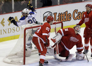 photo - Detroit Red Wings goalie Jimmy Howard (35) reacts after St. Louis Blues left wing Alexander Steen (20) scored during the overtime period of an NHL hockey game in Detroit, Wednesday, Feb. 13, 2013. St. Louis defeated the Red Wings 4-3. (AP Photo/Carlos Osorio)