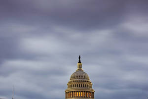 Photo - FILE - In this  Monday, Oct. 7, 2013, file photo, the Capitol in Washington is seen under an overcast sky at dawn.  If the deadline to raise the government's borrowing limit is breached, no one knows precisely what will happen.  (AP Photo/J. Scott Applewhite, File )