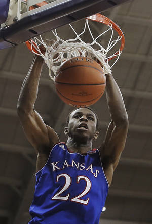 Photo - Kansas guard Andrew Wiggins (22) dunks in the first half of an NCAA college basketball game against TCU, Saturday, Jan. 25, 2014, in Fort Worth, Texas. (AP Photo/Brandon Wade)