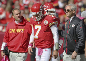 Photo -   Kansas City Chiefs quarterback Matt Cassel (7) walks off the field with trainers during the second half of an NFL football game against the Baltimore Ravens at Arrowhead Stadium in Kansas City, Mo., Sunday, Oct. 7, 2012. The Ravens defeated the Chiefs 9-6. (AP Photo/Colin E. Braley)