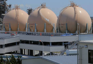 Photo - FILE - In this Aug. 22, 2012 file photo, liquefied petroleum gas storage tanks stand at an industrial area in Yokohama in Kanagawa prefecture, south of Tokyo. Japan's trade deficit in 2012 rose to a record 6.93 trillion yen ($78.3 billion), as fuel imports surged and a bitter territorial dispute with China hammered its exports. The provisional figures reported by the Finance Ministry on Thursday, Jan. 24, 2013 showed the trade deficit narrowed, however, in December, to 641.5 billion yen ($7.25 billion) from the 954.8 billion yen shortfall in November. (AP Photo/Itsuo Inouye, File)